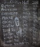 Menu in front of coffee Royalty Free Stock Image