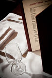 Menu with glass near it. Menu in restaurant with a glass near it Royalty Free Stock Photography