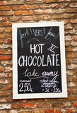 Menu with hot chocolate price on the wall Royalty Free Stock Image