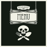 Menu with human skull with a spoon and fork Stock Image