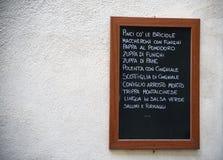 Menu italiano sulla parete Fotografie Stock