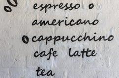 Menu kawa na białym ściana z cegieł Fotografia Royalty Free