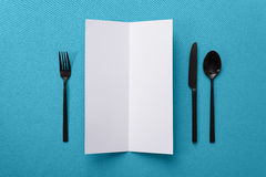 Menu mockup. Blank paper menu on blue background royalty free stock photography