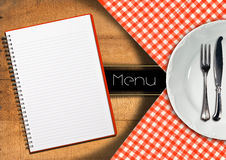 Menu with Notebook and White Plate Stock Images