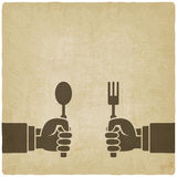 Menu old background. Hands with fork and spoon Royalty Free Stock Photo