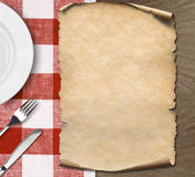 Menu paper on table with plate, knife and fork Royalty Free Stock Photo