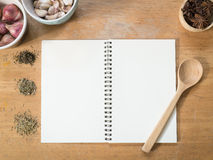 Menu paper template and Spicy herb ingredient. Top view - Blank white menu paper template  background and  Spicy herb ingredient for prepare food on wooden table Stock Photo