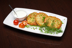 The menu - photo - unusual rissole with sour cream Stock Images