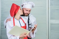 Menu planning. culinary cuisine. secret ingredient by recipe. cook uniform. man and woman chef in restaurant. Family royalty free stock images