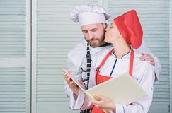Menu planning. culinary cuisine. secret ingredient by recipe. cook uniform. man and woman chef in restaurant. Family royalty free stock image