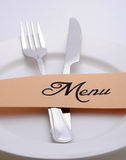 Menu. Plate with fork and knife Stock Photography