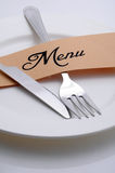 Menu. Plate with fork and knife Royalty Free Stock Photos