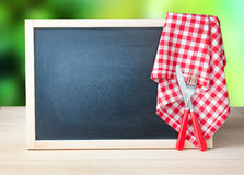Menu recipe blackboard desorated picnic cloth. Royalty Free Stock Photography