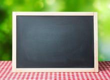 Menu recipe blackboard desorated picnic cloth. Blackboard empty space for text.Chalkboard background.Menu recipe advertisement concept picnic cloth Stock Images