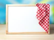 Menu recipe cafe white board background picnic cloth. White board in frame with picnic cloth on it.Recipe menu food service background empty copy space Royalty Free Stock Photos