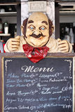 Menu in restaurant. An old worn out chalkboard displaying the menu in a cafe Stock Image