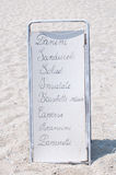 Menu of a restaurant on the beach where there is' wrote: Royalty Free Stock Images