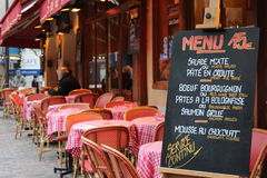 Menu at the restaurant in Paris,France. Tables outside the restaurant in the city ready to eat lunch Stock Photos