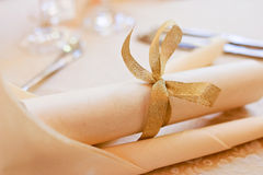 Menu roll tied with gold ribbon Stock Image
