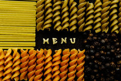 Menu sign arranged by pasta, on black Stock Photos