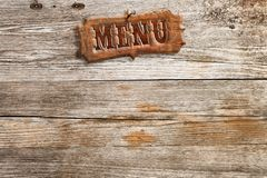 Menu sign on wood panel Royalty Free Stock Photography
