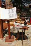 Menu of small outdoor cafe in greek village Stock Photography