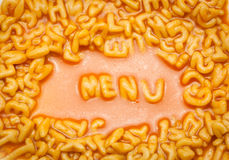 Menu spelt with spaghetti letters Royalty Free Stock Photo