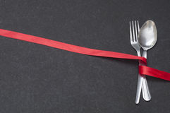 Menu Spoon and Fork with Ribbon Royalty Free Stock Photography