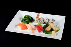 Menu of sushi and roll fish with vegetables on white plate Royalty Free Stock Images