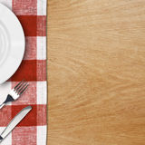 Menu template. Plate, fork and knife on table with tablecloth Stock Photo
