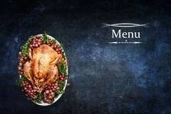 Menu with Roast Turkey over Chalkboard Texture Background Royalty Free Stock Photos