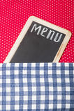 Menu. Title written with chalk on blackboard lying on tablecloth red polka dot Royalty Free Stock Photography