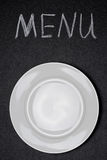 Menu title written with chalk and empty plate Stock Image