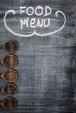 Menu title written with chalk. On blackboard Stock Photos