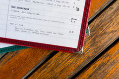 Menu on Wooden Table (1). Drinks Menu of Table with Prices Stock Photo
