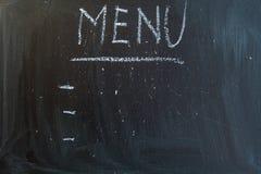 Menu. Written on a blackboard Stock Image