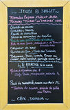 Menu written in French on the blackboard of a restaurant Royalty Free Stock Photo
