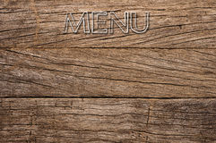 Menu written on wooden background Royalty Free Stock Photography