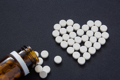 Meny different white pills. Medicine background from much capsul Stock Photos