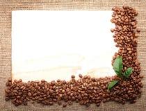 Menyn Design.Old skyler över brister, kaffebönan royaltyfria bilder