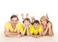 Menzogne di famiglia di quattro Fotografia Stock Libera da Diritti