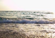 Mer au coucher du soleil images stock