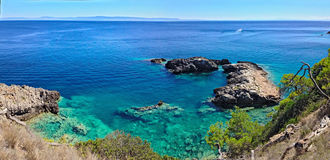 Mer bleue dans S Île de domino photos stock