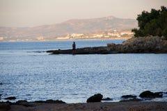 Mer d'été de Fisher Rhodos Greece Photos stock