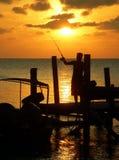 Mer de Sulu de coucher du soleil de pêcheur de jetée Images libres de droits