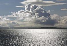 Mer et nuages excessifs Image libre de droits