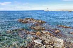 Mer et phare Photos stock