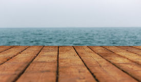 Mer et plancher en bois Images libres de droits