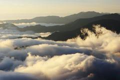 Mer grande des nuages avec le coucher du soleil Photographie stock
