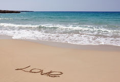 Mer, sable et amour Image stock